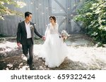 young marriage couple in rustic ... | Shutterstock . vector #659322424
