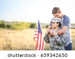husband hugs wife in the army | Shutterstock . vector #659342650