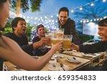 group of friends celebrating... | Shutterstock . vector #659354833