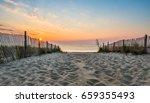 delaware beach sunrise | Shutterstock . vector #659355493