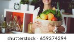young woman holding grocery...   Shutterstock . vector #659374294