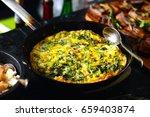 fritata italian egg omelette | Shutterstock . vector #659403874
