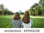 back view of two young woman... | Shutterstock . vector #659443228