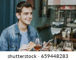young man mobile drinking beer | Shutterstock . vector #659448283
