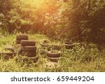 old tire on ground | Shutterstock . vector #659449204