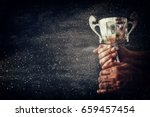 low key image of a man holding... | Shutterstock . vector #659457454