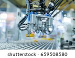 industrial robot with conveyor... | Shutterstock . vector #659508580