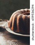 bundt cake with icing sugar.... | Shutterstock . vector #659536294