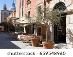 Small photo of Venice,Italy - Merch 28, 2015: Street cafe with olives in pots, Venice, Italy