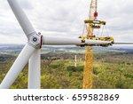 aerial view of wind turbine... | Shutterstock . vector #659582869
