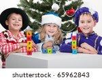 Three Children Dressed In...