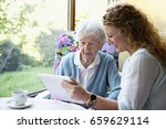 young woman teaching senior... | Shutterstock . vector #659629114