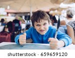 hungry angry little boy waiting ... | Shutterstock . vector #659659120