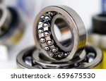 Small photo of Industrial ball bearing. Friction bearing. Angular contact ball bearing.
