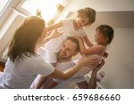 cheerful family playing... | Shutterstock . vector #659686660