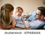 happy family lying on floor... | Shutterstock . vector #659686666