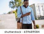 fun young man checking... | Shutterstock . vector #659689084