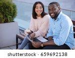 sweet positive couple deciding... | Shutterstock . vector #659692138