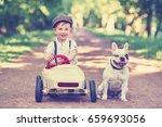 cute little boy in pedal car...   Shutterstock . vector #659693056