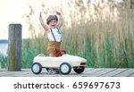 active little boy driving pedal ... | Shutterstock . vector #659697673