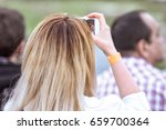 blurred people blonde woman... | Shutterstock . vector #659700364