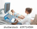 mature female doctor working at ... | Shutterstock . vector #659714584