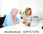 mature woman helping assisted... | Shutterstock . vector #659717278