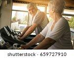 senior couple on jogging... | Shutterstock . vector #659727910