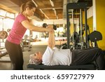 personal trainer working... | Shutterstock . vector #659727979
