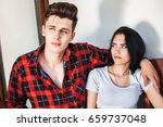 the girl seriously looks at his ... | Shutterstock . vector #659737048