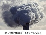 Small photo of Air pollution from power plant chimneys.