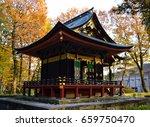 Stock photo shinto shrine building in a park 659750470