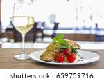 seared salmon fillet with wine... | Shutterstock . vector #659759716