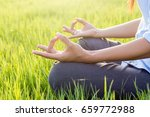 young woman practicing yoga ... | Shutterstock . vector #659772988