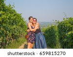 happy wine tourists visiting... | Shutterstock . vector #659815270