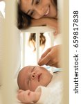 mother putting baby to sleep at ... | Shutterstock . vector #659817838