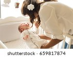 mother putting baby to sleep at ... | Shutterstock . vector #659817874