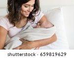 lovely mother holding newborn... | Shutterstock . vector #659819629