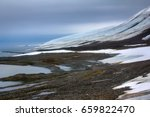 Small photo of Marine terraces as transgressions of world ocean (adsorption of sea) and melting of glaciers, climatic variations, melting ice. Arctic, Franz Josef Land