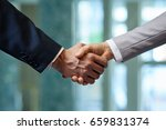 close up shot of firm handshake ... | Shutterstock . vector #659831374