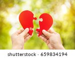 two hand holding connecting two ... | Shutterstock . vector #659834194