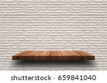empty wooden shelf on old white ... | Shutterstock . vector #659841040