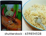 Small photo of Instant noodle And food images on the phone, concepts affect health.