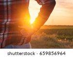 concerned female farmer... | Shutterstock . vector #659856964