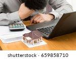stress from home debt | Shutterstock . vector #659858710