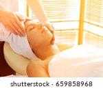 young woman receiving facial... | Shutterstock . vector #659858968