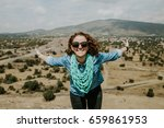 young carefree female tourist... | Shutterstock . vector #659861953