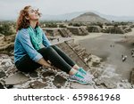 young carefree female tourist... | Shutterstock . vector #659861968