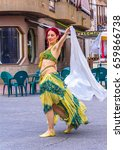 Small photo of EL ALAMO, MADRID, SPAIN. APRIL 30, 2017: Belly dancer in the medieval market of El Alamo, Madrid.