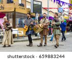 Small photo of EL ALAMO, MADRID, SPAIN. APRIL 30, 2017: A group of street musicians entertain people in the medieval market of El Alamo in Madrid.